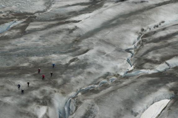 A ribbon of glacial melt, a cluster of ice hikers on Exit Glacier, AK